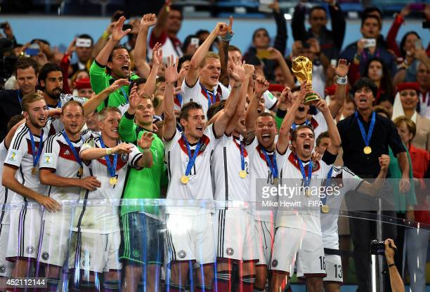 Philipp Lahm of Germany lifts the World Cup to celebrate with his teammates during the award ceremony after the 2014 FIFA World Cup Brazil Final...