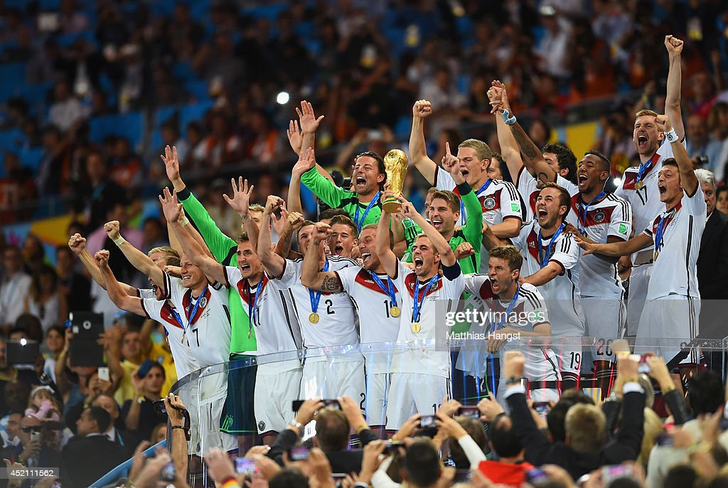 Philipp Lahm of Germany lifts the World Cup trophy after defeating Argentina 10 in extra time during the 2014 FIFA World Cup Brazil Final match...