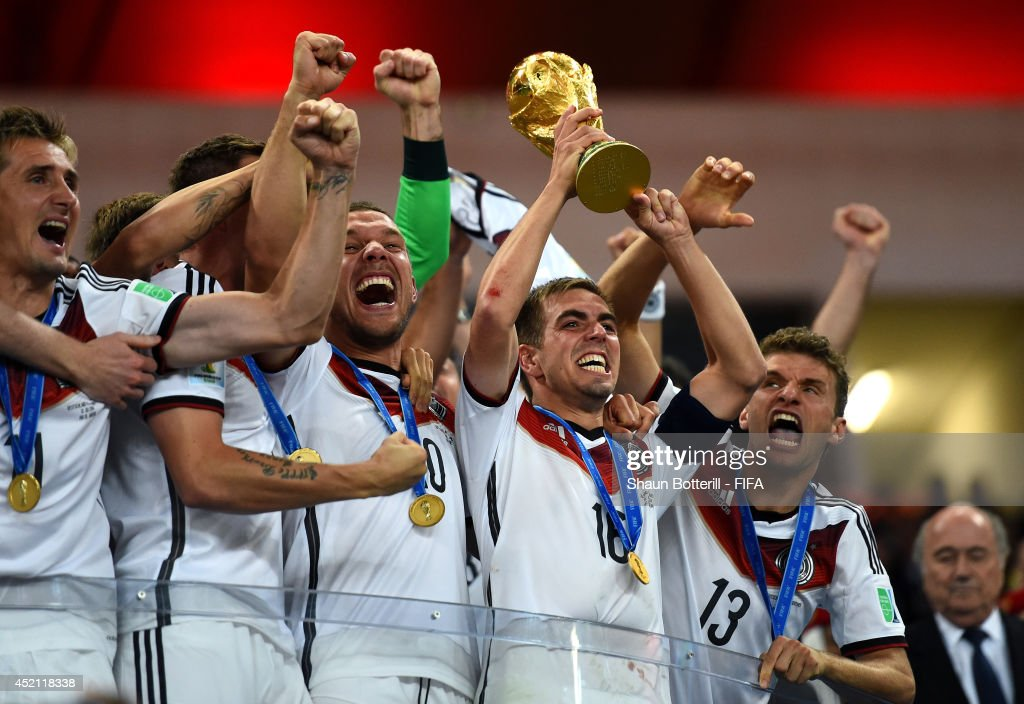 <a gi-track='captionPersonalityLinkClicked' href=/galleries/search?phrase=Philipp+Lahm&family=editorial&specificpeople=483746 ng-click='$event.stopPropagation()'>Philipp Lahm</a> of Germany lifts the World Cup trophy to celebrate with his teammates during the award ceremony after the 2014 FIFA World Cup Brazil Final match between Germany and Argentina at Maracana on July 13, 2014 in Rio de Janeiro, Brazil.