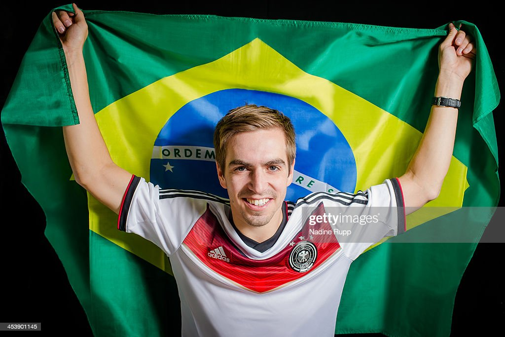 Philipp Lahm of Germany poses with the Brazilian flag ahead of the 2014 FIFA World Cup in Brazil on December 3, 2013 in Munich, Germany.