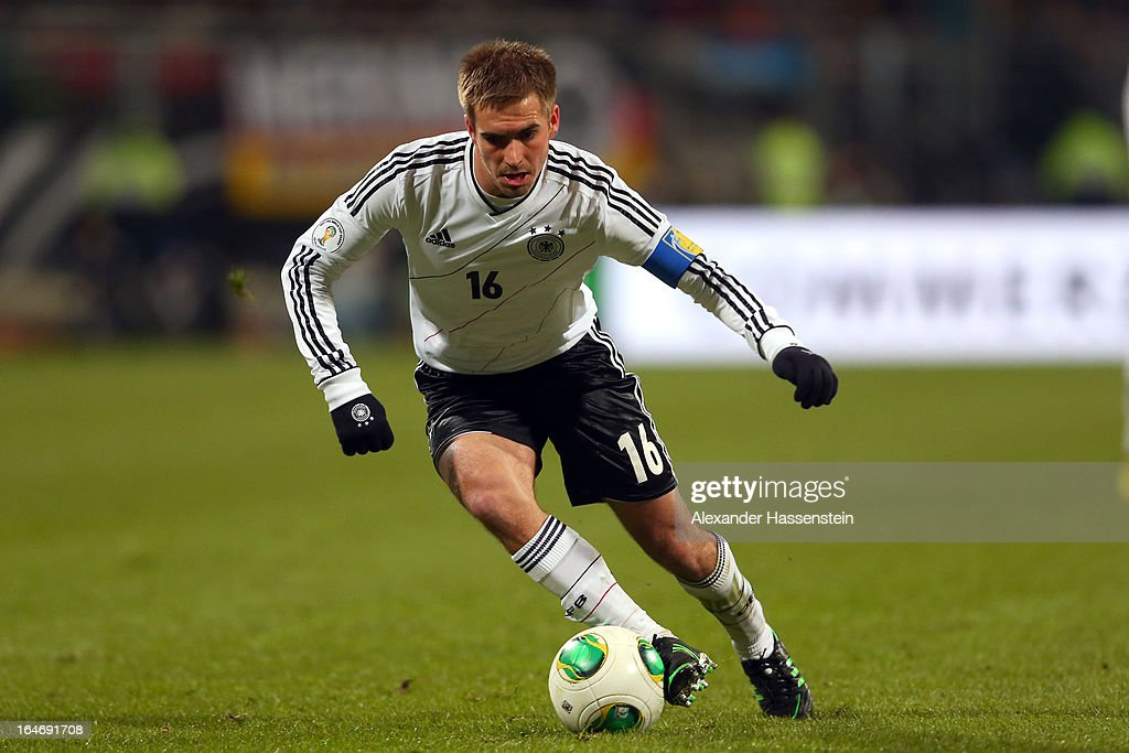 Philipp Lahm of Germany runs with the ball during the FIFA 2014 World Cup qualifier group C match between Germany and Kazakhstan at Gundig-Stadion on March 26, 2013 in Nuremberg, Germany.