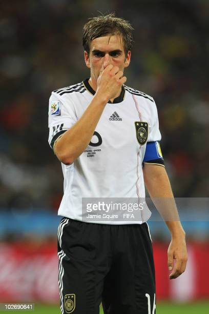 Philipp Lahm of Germany shows his dejection during the 2010 FIFA World Cup South Africa Semi Final match between Germany and Spain at Durban Stadium...