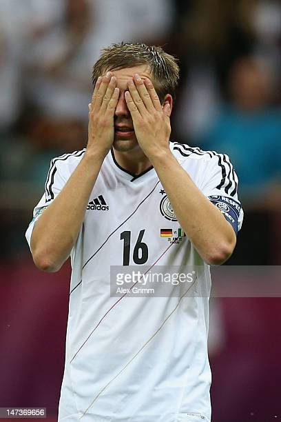 Philipp Lahm of Germany shows his dejection during the UEFA EURO 2012 semi final match between Germany and Italy at the National Stadium on June 28...