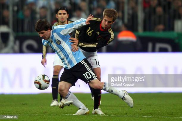 Philipp Lahm of Germany tackles Lionel Messi of Argentina during the International Friendly match between Germany and Argentina at the Allianz Arena...
