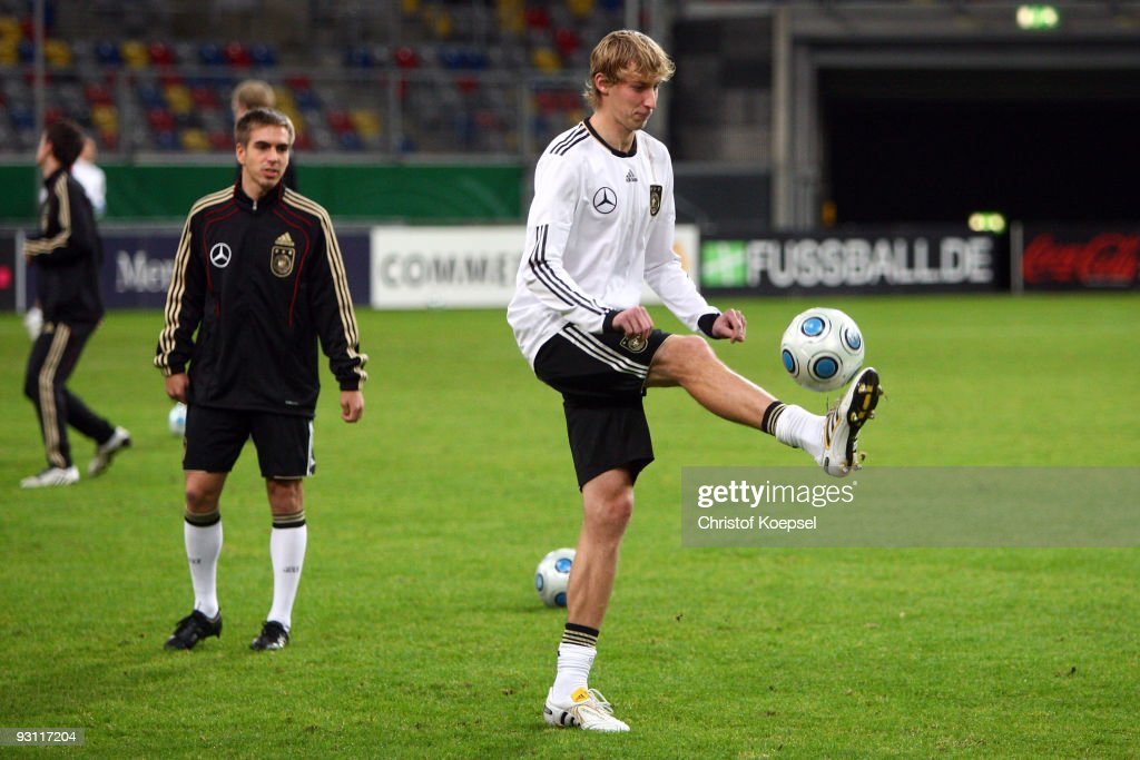 Philipp Lahm of Germany watches team mate Stefan Kiessling juggling with the ball during a German National team training session at the Esprit Arena...
