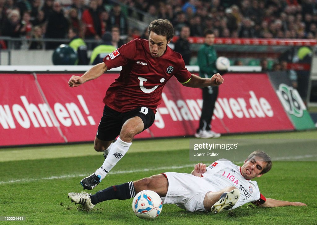 Philipp Lahm of Muenchen and Steven Cherundolo of Hannover battle for the ball during the Bundesliga match between Hannover 96 and FC Bayern Muenchen...