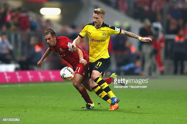 Philipp Lahm of Muenchen battles for the ball with Marco Reuss of Dortmund during the Bundesliga match between FC Bayern Muenchen and BVB Borussia...