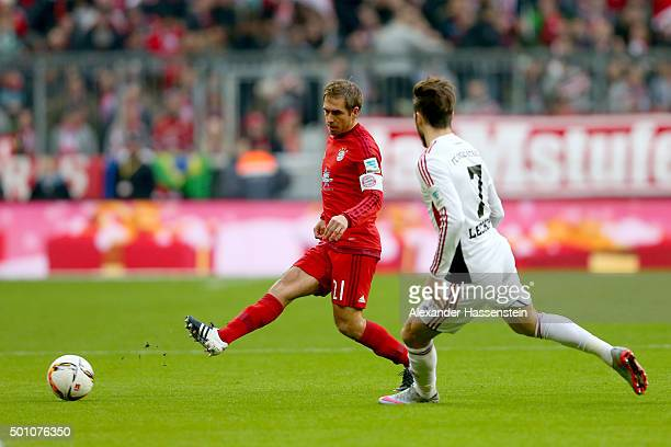 Philipp Lahm of Muenchen battles for the ball with Mathew Leckie of Ingolstadt during the Bundesliga match between FC Bayern Muenchen and FC...