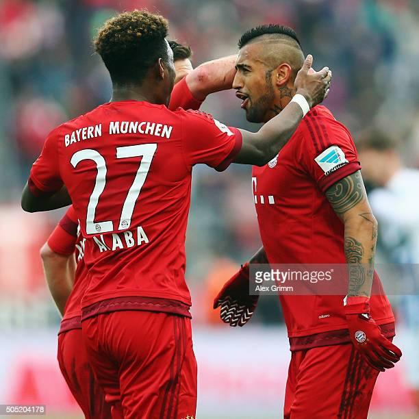 Philipp Lahm of Muenchen celebrates his team's first goal with team mate David Alaba during a friendly match between Karlsruher SC and FC Bayern...