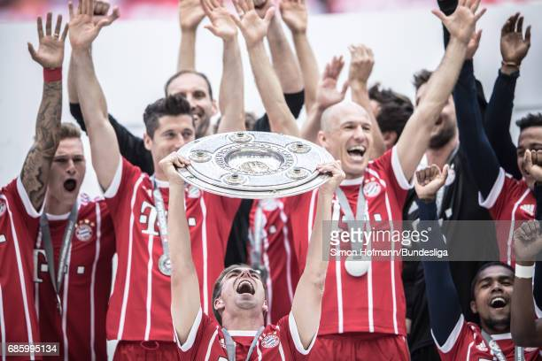 Philipp Lahm of Muenchen celebrates with the trophy after the Bundesliga match between Bayern Muenchen and SC Freiburg at Allianz Arena on May 20...