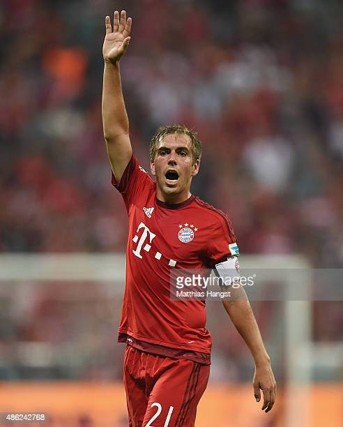 Philipp Lahm of Muenchen gestures during the Bundesliga match between FC Bayern Muenchen and Bayer Leverkusen at Allianz Arena on August 29 2015 in...