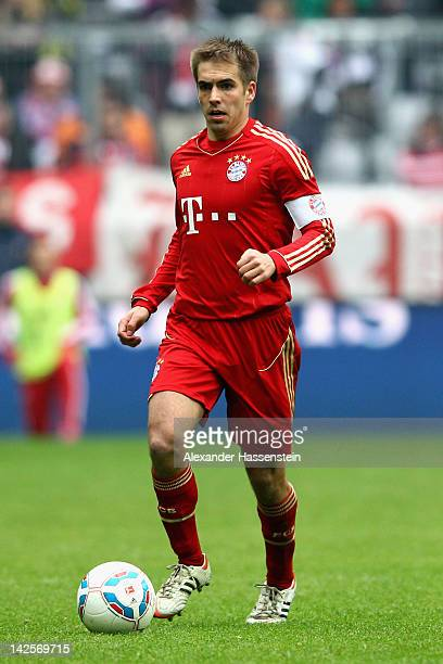 Philipp Lahm of Muenchen holds the ball during the Bundesliga match between FC Bayern Muenchen and FC Augsburg at Allianz Arena on April 7 2012 in...