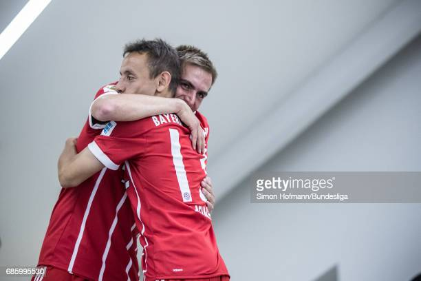 Philipp Lahm of Muenchen hugs team mate Rafinha in the player's tunnel after the Bundesliga match between Bayern Muenchen and SC Freiburg at Allianz...