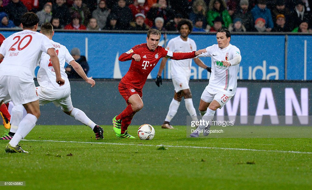 <a gi-track='captionPersonalityLinkClicked' href=/galleries/search?phrase=Philipp+Lahm&family=editorial&specificpeople=483746 ng-click='$event.stopPropagation()'>Philipp Lahm</a> of Muenchen (L) is challenged by with <a gi-track='captionPersonalityLinkClicked' href=/galleries/search?phrase=Piotr+Trochowski&family=editorial&specificpeople=635014 ng-click='$event.stopPropagation()'>Piotr Trochowski</a> of Augsburg (R) during the Bundesliga match between FC Ausgburg and FC Bayern Muenchen at SGL Arena on February 14, 2016 in Augsburg, Germany.