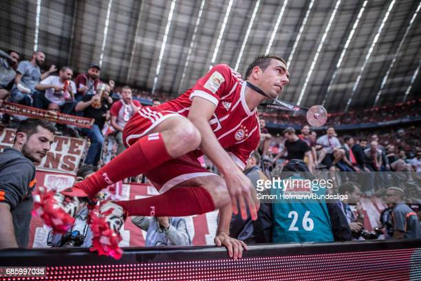 Philipp Lahm of Muenchen jumps over the advertising board after the Bundesliga match between Bayern Muenchen and SC Freiburg at Allianz Arena on May...