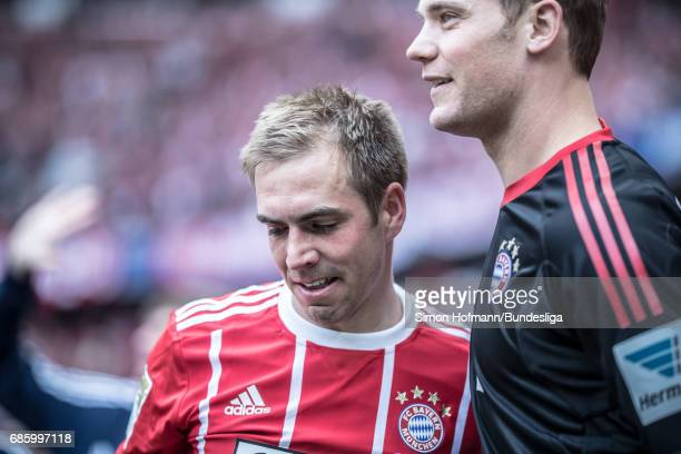 Philipp Lahm of Muenchen reacts as he hugs team mate Manuel Neuer during the Bundesliga match between Bayern Muenchen and SC Freiburg at Allianz...