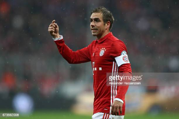 Philipp Lahm of Muenchen reacts during the DFB Cup semi final match between FC Bayern Muenchen and Borussia Dortmund at Allianz Arena on April 26...