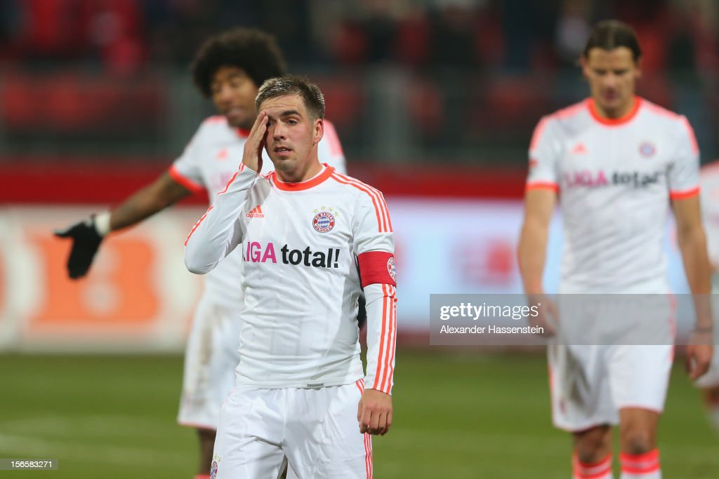 <a gi-track='captionPersonalityLinkClicked' href=/galleries/search?phrase=Philipp+Lahm&family=editorial&specificpeople=483746 ng-click='$event.stopPropagation()'>Philipp Lahm</a> (2nd L) of Muenchen reacts with his team mates Dante (L) and <a gi-track='captionPersonalityLinkClicked' href=/galleries/search?phrase=Daniel+van+Buyten&family=editorial&specificpeople=213252 ng-click='$event.stopPropagation()'>Daniel van Buyten</a> (R) after the Bundesliga match between 1. FC Nuernberg and FC Bayern Muenchen at Easy Credit Stadium on November 17, 2012 in Nuremberg, Germany.