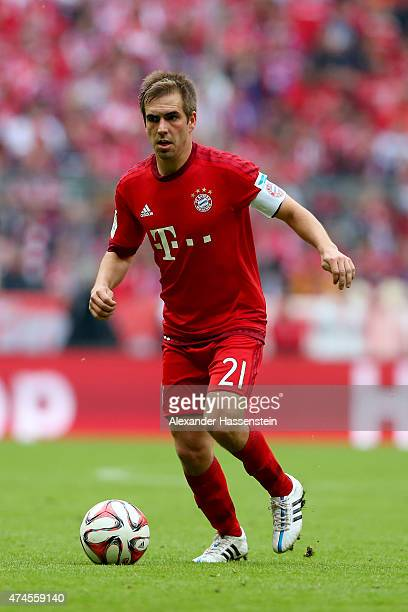 Philipp Lahm of Muenchen runs with the ball during the Bundesliga match between FC Bayern Muenchen and 1 FSV Mainz 05 at the Allianz Arena on May 23...