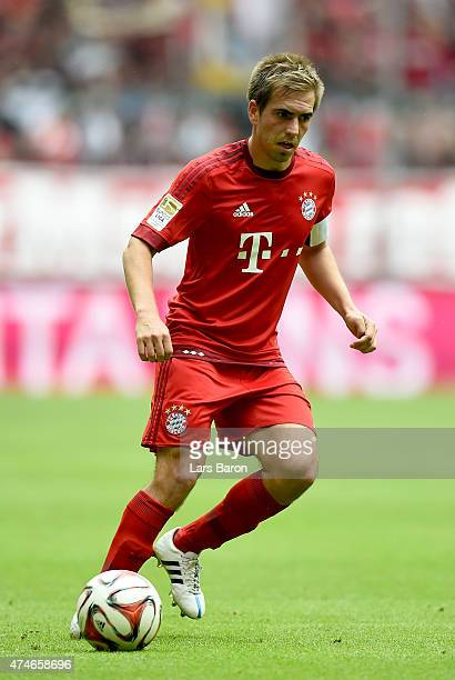 Philipp Lahm of Muenchen runs with the ball during the Bundesliga match between FC Bayern Muenchen and 1 FSV Mainz at Allianz Arena on May 23 2015 in...
