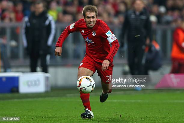 Philipp Lahm of Muenchen runs with the ball during the Bundesliga match between FC Bayern Muenchen and FC Ingolstadt at Allianz Arena on December 12...