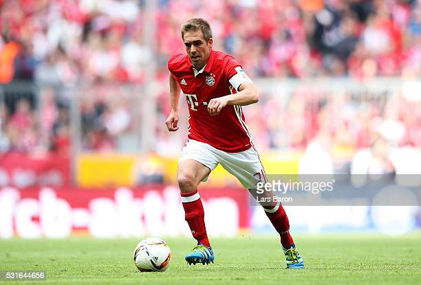 Philipp Lahm of Muenchen runs with the ball during the Bundesliga match between FC Bayern Muenchen and Hannover 96 at Allianz Arena on May 14 2016 in...