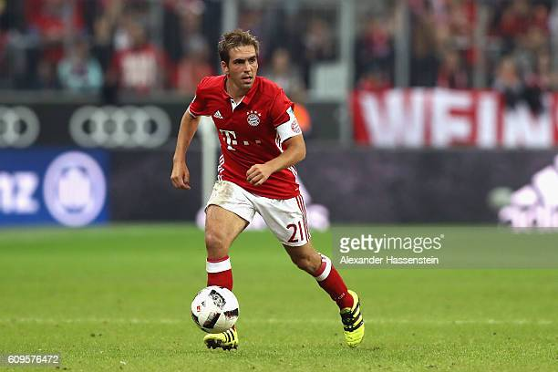 Philipp Lahm of Muenchen runs with the ball during the Bundesliga match between Bayern Muenchen and Hertha BSC at Allianz Arena on September 21 2016...