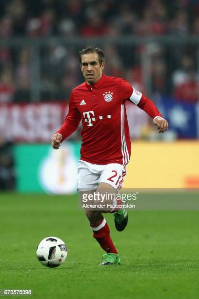 Philipp Lahm of Muenchen runs with the ball during the DFB Cup semi final match between FC Bayern Muenchen and Borussia Dortmund at Allianz Arena on...