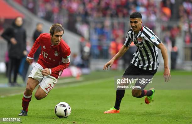 Philipp Lahm of Munich and Aymen Barkok of Frankfurt vie for the ball during the Bundesliga soccer match between FC Bayern Munich and Eintracht...