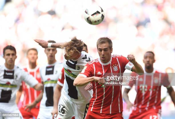 Philipp Lahm of Munich and Maximilian Philipp of Freiburg vie for the ball during the Bundesliga soccer match between FC Bayern Munich and SC...