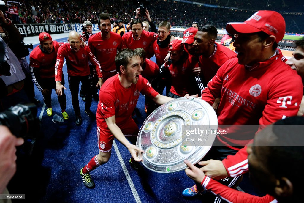 Philipp Lahm of Munich celebrates after the Bundesliga match between and Hertha BSC and FC Bayern Muenchen at Olympiastadion on March 25, 2014 in Berlin, Germany.
