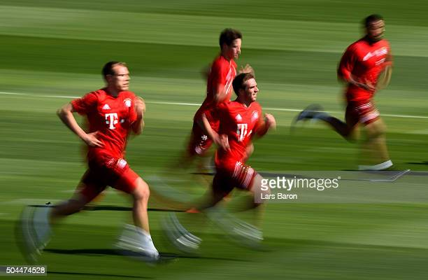 Philipp Lahm sprints with team mates during a training session at day six of the Bayern Muenchen training camp at Aspire Academ on January 11 2016 in...