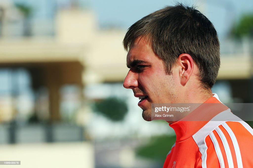 Philipp Lahm talks to the media during a Bayern Muenchen press conference at the Grand Heritage Hotel on January 4, 2013 in Doha, Qatar.