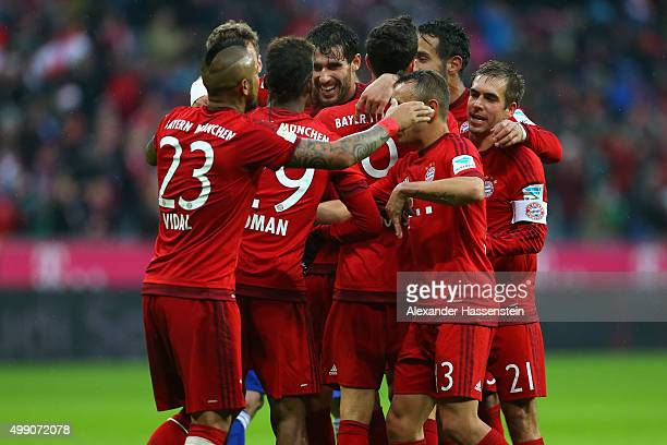 Philipp Lahm team captain of Muenchen celebrate with his team mates the second team goal during the Bundesliga match between FC Bayern Muenchen and...