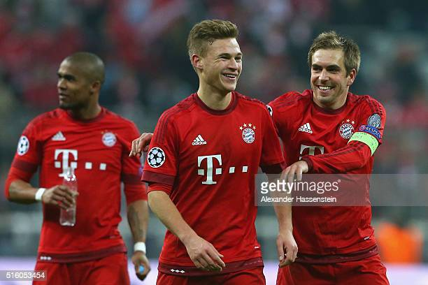 Philipp Lahm team captain of Muenchen celebrates victory with his team mate Joshua Kimmich after winning the UEFA Champions League Round of 16 Second...