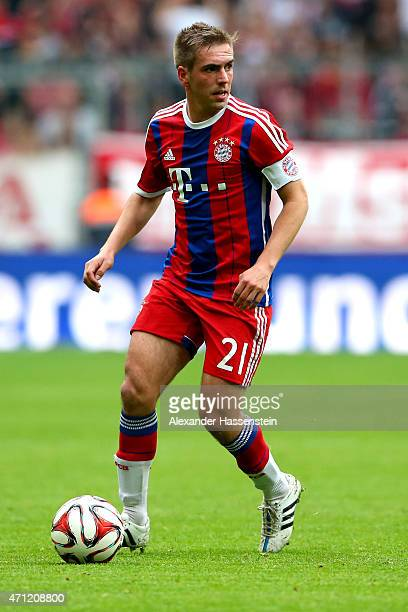 Philipp Lahm team captain of Muenchen runs with the ball during the Bundesliga match between FC Bayern Muenchen and Hertha BSC Berlin at Allianz...
