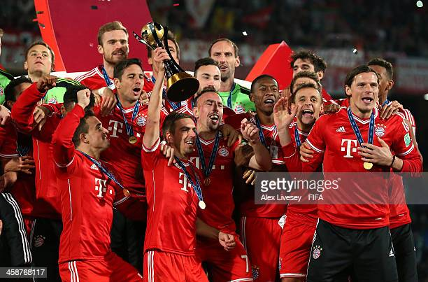 Philipp Lahm the captain of FC Bayern Munchen lifts the FIFA Club World Cup after victory in the FIFA Club World Cup Final between FC Bayern Munchen...