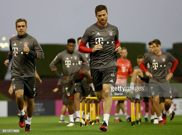 Philipp Lahm warms up next to Xavi Alonso during a training session at day 7 of the Bayern Muenchen training camp at Aspire Academy on January 9 2017...