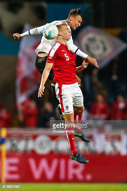 Philipp Lienhart of Austria competes for the ball in the air with Davie Selke of Germany during the 2017 UEFA European U21 Championships Qualifier...
