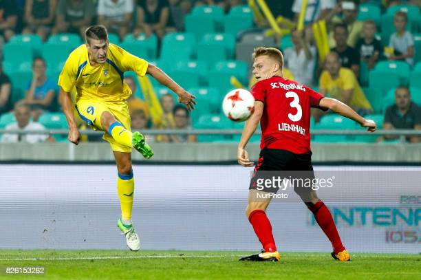 Philipp Lienhart of SC Freiburg and Lovro Bizjak of NK Domzale battle for the ball during the UEFA Europa League Third Qualifying Round match between...