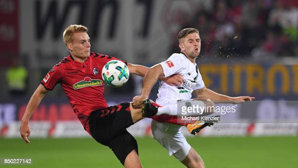 Philipp Lienhart of SC Freiburg challenges Niclas Fuellkrug of Hannover 96 during the Bundesliga match between Sport Club Freiburg and Hannover 96 at...