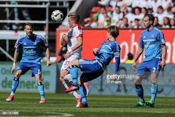 Philipp Max of Augsburg and Gotoku Sakai of Hamburg battle for the ball during the Bundesliga match between FC Augsburg and Hamburger SV at WWK Arena...
