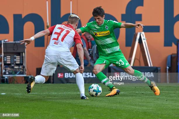 Philipp Max of Augsburg and Jonas Hofmann of Moenchengladbach battle for the ball during a Bundesliga match between FC Augsburg and Borussia...