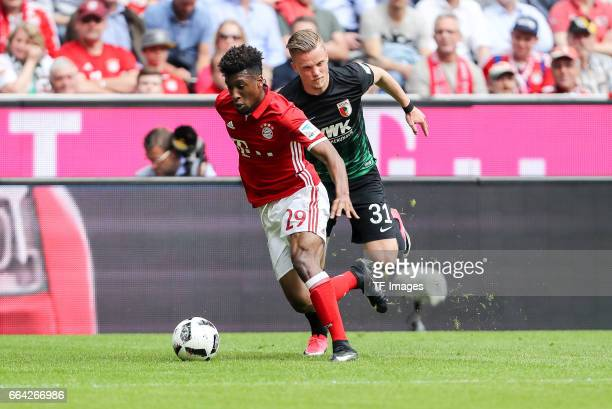 Philipp Max of Augsburg and Kingsley Coman of Munich battle for the ball during the Bundesliga match between Bayern Muenchen and FC Augsburg at...
