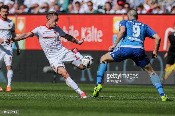Philipp Max of Augsburg and Kyriakos Papadopoulos of Hamburg battle for the ball during the Bundesliga match between FC Augsburg and Hamburger SV at...