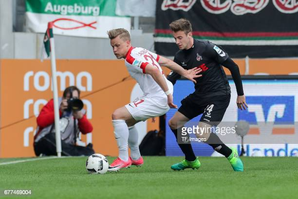 Philipp Max of Augsburg and Lukas Kluenter of Colonge battle for the ball during the Bundesliga match between FC Augsburg and 1 FC Koeln at WWK Arena...