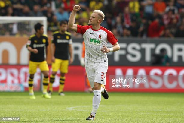 Philipp Max of Augsburg celebrates after Caiuby of Augsburg scored the first goal for Augsburg to make it 11 during the Bundesliga match between FC...