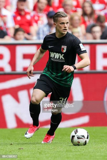Philipp Max of Augsburg controls the ball during the Bundesliga match between Bayern Muenchen and FC Augsburg at Allianz Arena on April 1 2017 in...