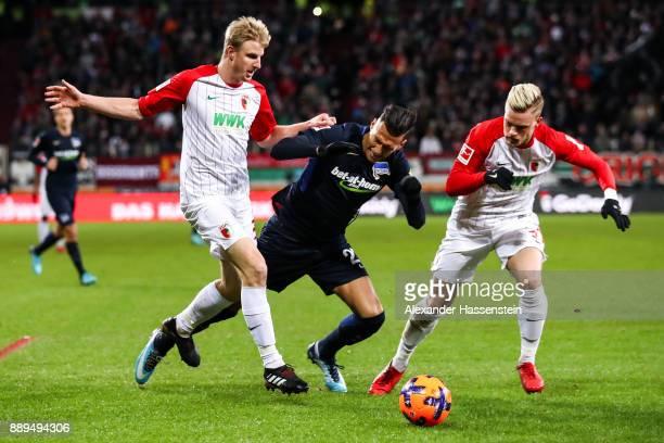 Philipp Max of Augsburg Davie Selke of Hertha Berlin and Martin Hinteregger of Augsburg battle for the ball during the Bundesliga match between FC...