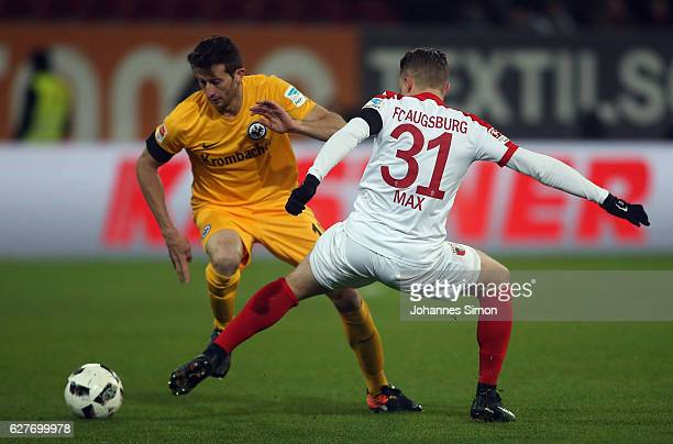 Philipp Max of Augsburg fights for the ball with David Angel Abraham of Frankfurt during the Bundesliga match between FC Augsburg and Eintracht...